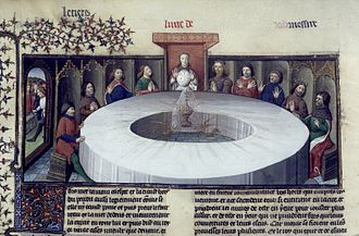 Round Table - King Arthur's knights, gathered at the Round Table, see a vision of the Holy Grail. From a manuscript of Lancelot and the Holy Grail (c. 1406)