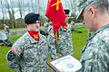 Army Col. Phillip Jolly, right, the commander of the 364th Expeditionary Sustainment Command, presents a certificate of achievement to Soldiers from Charlie Battery, 2nd Battalion, 12th Field Artillery Regiment 120401-A-RB545-015.jpg