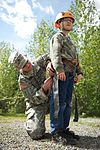 Army Staff Sgt. Christopher Sells inspects the harness of his son, Arron, 9.jpg