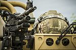 As troops wait for the next element, a helmet is put aside next to a GPMG. MOD 45160149.jpg