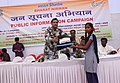 Asst. Commandant, CRPF, Shri Satyaveer singh presenting prize to a student at the Public Information Campaign on Bharat Nirman, at Majhgain, Chandauli, (UP) on October 31, 2013.jpg