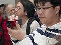 Attendee taking photo with Lytro light field camera (front).jpg
