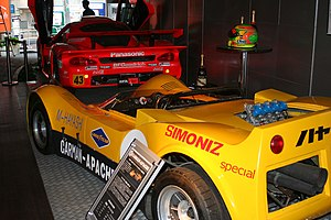 Autobacs Seven - Autobacs Bar lobby (Roppongi, Tokyo) featuring an Autobacs Garaiya GT300 and the 1969 Carman-Apache
