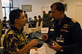 Bangladesh Navy Cmdr. Abu Taher Mohd Rezaul Hassan, right, discusses an earthquake disaster response scenario with a Nepalese soldier during Pacific Endeavor 2013 in Chonburi, Thailand, Aug. 26, 2013 130826-F-MT955-001.jpg