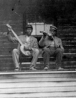 Snowden Family Band - Lew and Ben Snowden on banjo and fiddle at their home in Clinton, Knox County, Ohio, c. 1890s