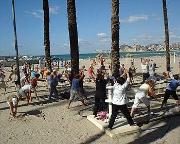 English: exercising on Benidorm beach
