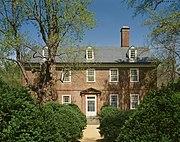 Photo of a three-story brick house