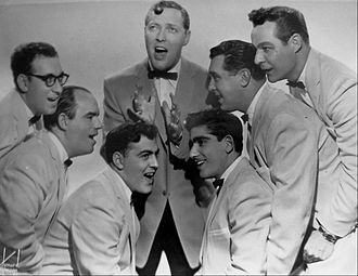 Bill Haley & His Comets - Bill Haley and His Comets in 1956. Left to right: Rudy Pompilli, Billy Williamson, Al Rex, Bill Haley, Johnny Grande, Ralph Jones, Franny Beecher