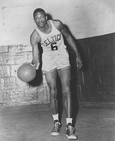 Bill Russell starred on 11 NBA title teams in 13 years as a Celtic. Bill russell dribbling.jpg