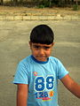 Blue clothed little cyclist boy - cycling near Nishapur railway station 07.JPG