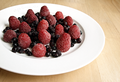 Blueberries and raspberries in a plate.png