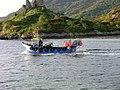 Boat Cruising past Eilan Ban - panoramio.jpg