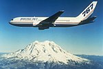 Boeing 767 over Mount Rainier, circa 1980s.jpg
