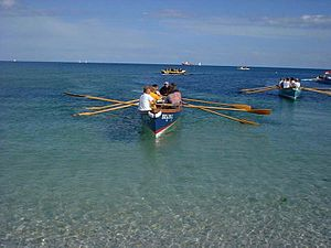 Coastal and offshore rowing - A Cornish pilot gig, a six crew boat returning from a race at Falmouth in Cornwall.