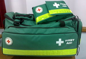 First aid kit - Large and small first aid kits used by the British Red Cross for event first aid, in the internationally recognised ISO green with a white cross.  These kits also feature the red cross which is a protected symbol under the Geneva Conventions and may only be used by the Red Cross or military
