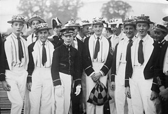 "Eton College - Pupils at Eton College dressed as members of various rowing crews taking part in the ""Procession of Boats"" on the River Thames during the ""Fourth of June"" celebrations 1932"