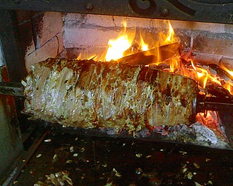 Doner kebab - Cağ kebabı, a related dish. Note that the meat is horizontally stacked.