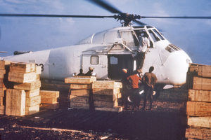 Biafran airlift - A helicopter, which has landed at a makeshift airport in Calabar, Nigeria, is loaded with crates of dried fish, a favorite food in that area, to be shipped to refugee camps during the Nigerian-Biafran war.