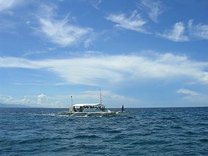 Camotes Sea - An outrigger on the sea near Olango Island