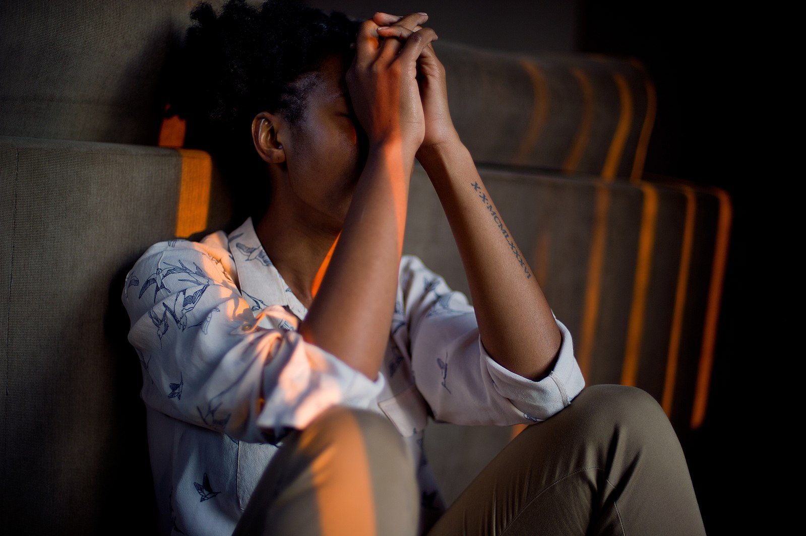 Stressed woman with head in hands