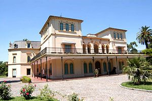 Avellaneda Park Historic Train - The Olivera Mansion (built in 1868) is surrounded by the train.