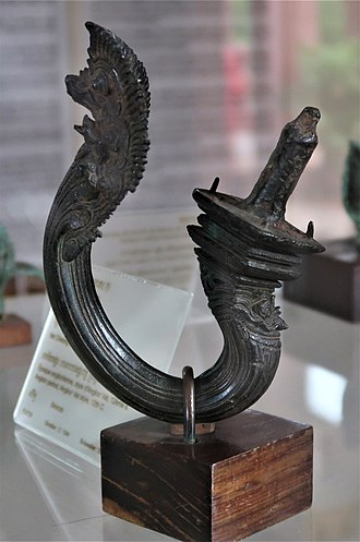 Chair - A bronze chair leg (dating back to 12th century). Leg is from Angkor (Cambodia) and is crafted in Angkor Wat style.
