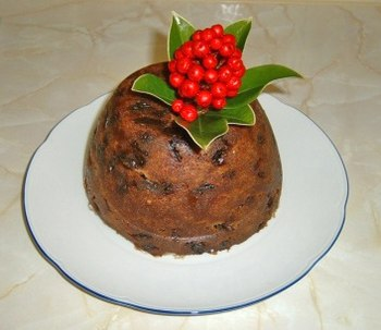 Christmas pudding decorated with skimmia rathe...