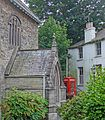 Church porch and phone box (28767529600).jpg
