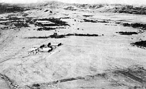 History of Clark Air Base - 1941: Clark Field in Angeles, Pampanga looking westward. In the upper left center, abutting the foothills of the Zambales Mountains, lies Fort Stotsenburg. The rectangular, tree-lined area is the parade ground.