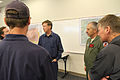 Colorado Gov. John Hickenlooper, center left, and U.S. Army Maj. Gen. H. Michael Edwards, center right, the adjutant general of the Colorado National Guard, meet with civilian authorities supporting efforts to 130614-Z-OS947-096.jpg