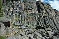 Columnar-jointed rhyolitic obsidian lava flow (Roaring Mountain Member, Plateau Rhyolite, Upper Pleistocene, ~59 ka; Obsidian Cliff, Yellowstone, Wyoming, USA) 29 (32943306258).jpg