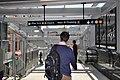 Court Square Subway IRT Flushing Line corridor to escalators (5793946483).jpg