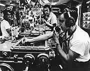 Crewmen in the Main Battery Plot of USS Canberra (CAG-2) off Vietnam, in March 1967 (USN 1142153)