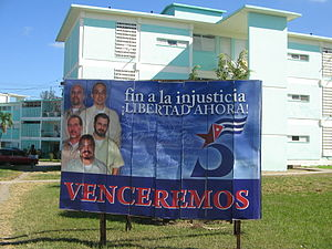 "Cuban Five - A billboard for the Cuban Five in Santa Clara. The number ""5"" with a star and a Cuban flag, shown in the picture, is used as a logo for the cause of the Five."