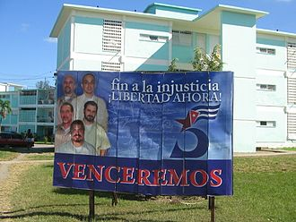 """Cuban Five - A billboard for the Cuban Five in Santa Clara. The number """"5"""" with a star and a Cuban flag, shown in the picture, is used as a logo for the cause of the Five."""