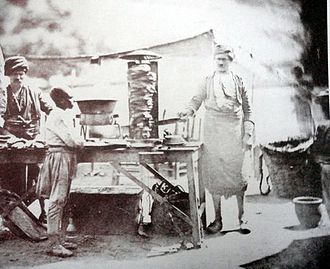 Gyro (food) - The earliest known photo of meat cooked on a vertical rotisserie AKA Döner, by James Robertson, 1855, Ottoman Empire.