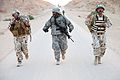 Defense.gov News Photo 110504-A-EM978-100 - A U.S. Army soldier 2nd from left assigned to Charlie Company 703rd Brigade Support Battalion 4th Advise and Assist Brigade 3rd Infantry.jpg