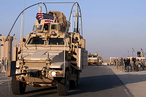 Defense.gov News Photo 111218-A-9999W-432 - A U.S. flag flies from a Mine Resistant Ambush Protected vehicle part of the last convoy to leave Iraq as it crosses over into Kuwait signaling.jpg
