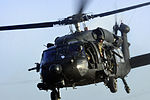 Defense.gov News Photo 120308-A-CD129-001 - A U.S. Army crew chief observes the horizon from the side door of a UH-60 Black Hawk helicopter as they prepare to land on a helipad at Camp.jpg