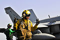 Defense.gov News Photo 120315-N-ZI635-705 - U.S. Navy Seaman Cody Ottmo directs an F A-18C Hornet on the flight deck of the USS Carl Vinson in the Arabian Sea on March 15 2012. Ottmo is an.jpg