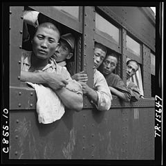 Discharged Japanese soldiers crowd trains as they take advantage of free transportation to their homes after end of... - NARA - 520938.jpg