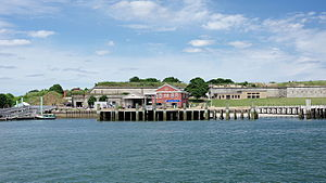 Georges Island (Massachusetts) - View from the water of the dock, visitor center, and fort entrance.