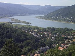 The Danube Bend is a curve of the Danube in Hungary, near the city of Visegrád. The Transdanubian Medium Mountains lie on the left bank, while the Northern Medium Mountains on the right.