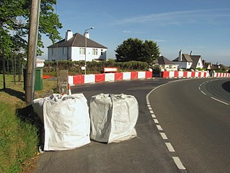 Isle of Man TT Mountain Course - The A3 Castletown to Ramsey road approaching Douglas Road Corner, Kirk Michael with safety air fencing on the outside of the bend