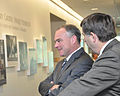 Dr. Robert Gates, right, vice president of the Dahlgren Heritage Foundation, discusses historic work accomplished at Dahlgren with Sen. Tim Kaine at the University of Mary Washington Dahlgren Campus in King 130827-N-CE356-001.jpg