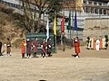 Drukpas enjoying their traditional archery games - panoramio.jpg