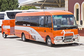 NSW TrainLink - Dyson Group Mitsubishi Fuso Rosa at Wagga Wagga station in January 2015