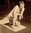 Eakins, Thomas (1844-1916) - 1885 ca. - Male nude crouching in sunlit rectangle in Pennsylvania Academy studio.jpg