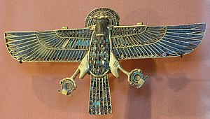 Faravahar - Egyptian Horbehutet (Horus of Behdet), holding Shen rings in his grasp (Louvre Museum)