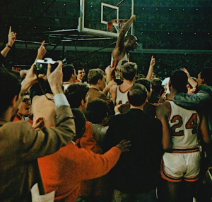 Game of the Century (college basketball) - Houston's Elvin Hayes is carried in a victory celebration on the Astrodome's floor